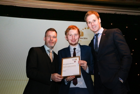 Doug Faulkner collecting his award for student journalist of the year